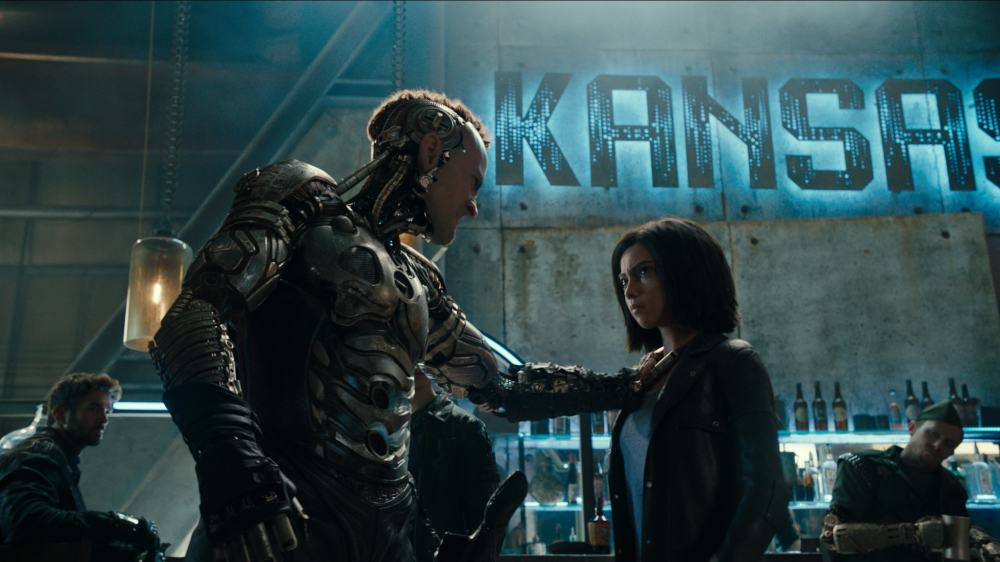 Ed Skrein and Rose Salazar in Alita: Battle Angel